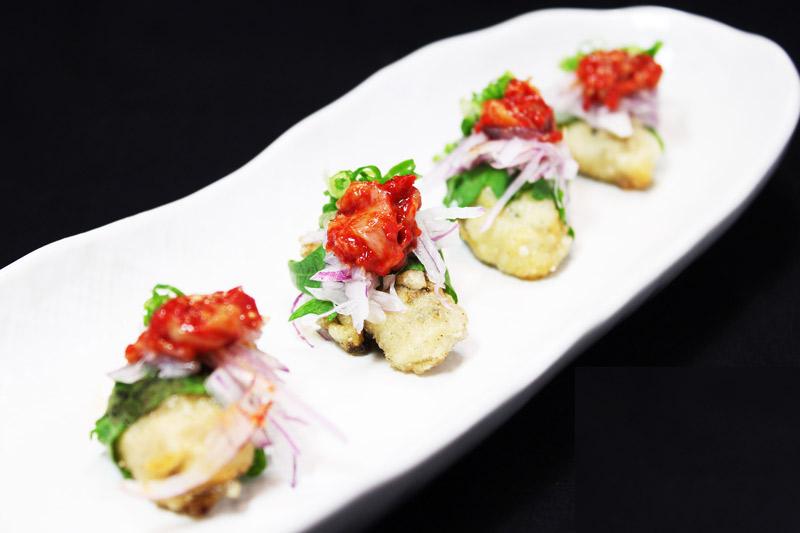 カキの唐揚げタラチャンジャ和え<br>Deep Fried Oysters tossed in spicy Korean cod