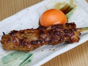 月見つくね(1本)<br>Grilled Minced Chicken Meatball Skewers with an egg yolk